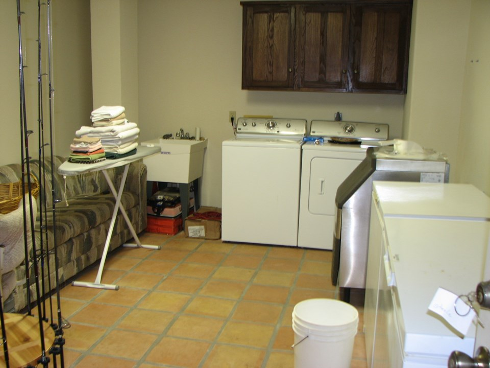 large laundry room plenty of storage for all your fishing equipment; ice maker; two freezers; large sink, etc.