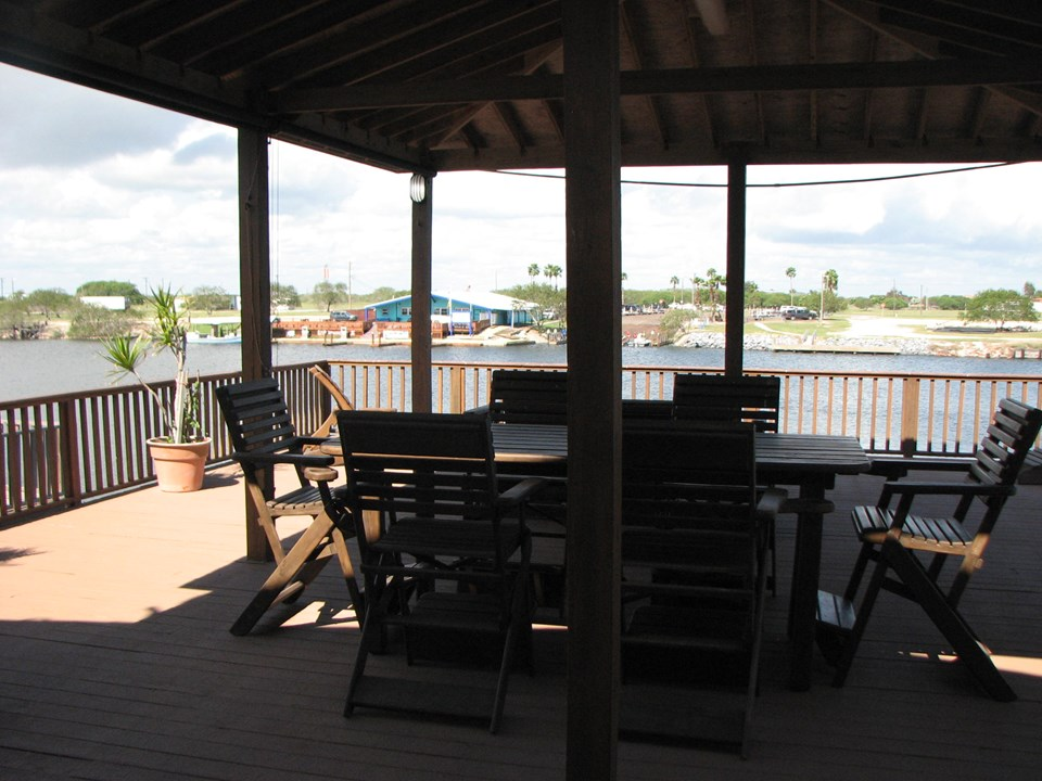 covered deck upstairs with plenty of seating for everyone!