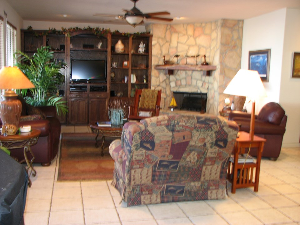plenty of built-ins in the living room with a working fireplace to your right (not in the picture) is a small wetbar area.