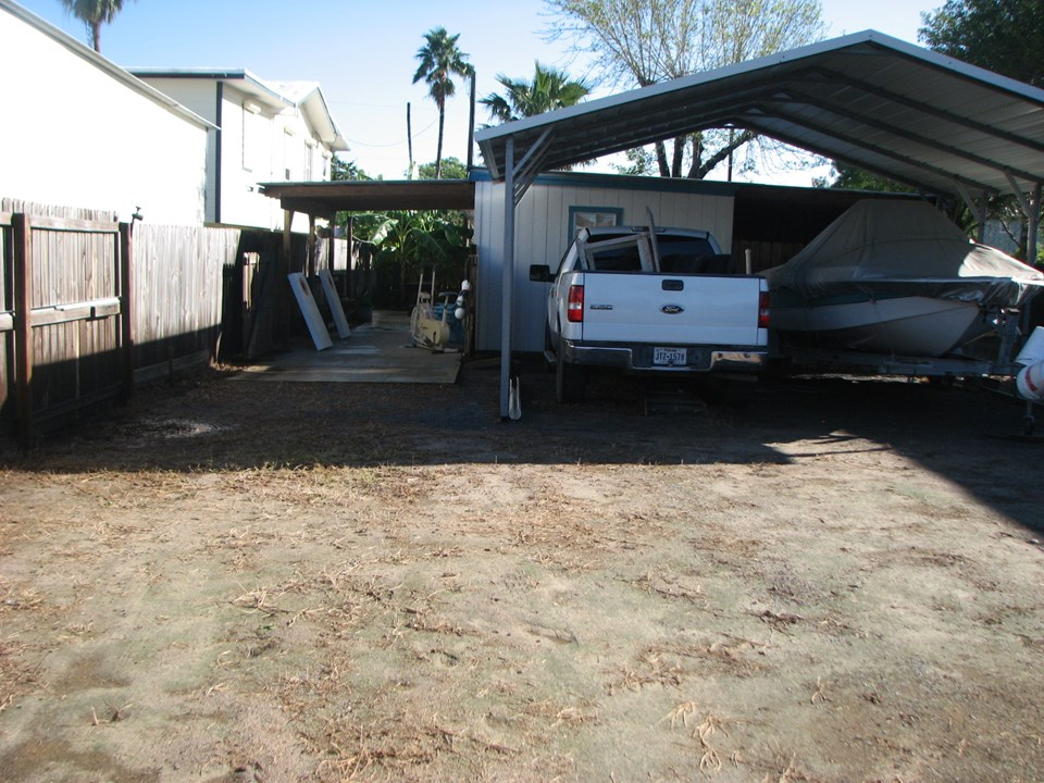 looking from the rear of the property toward the bar-b-q area