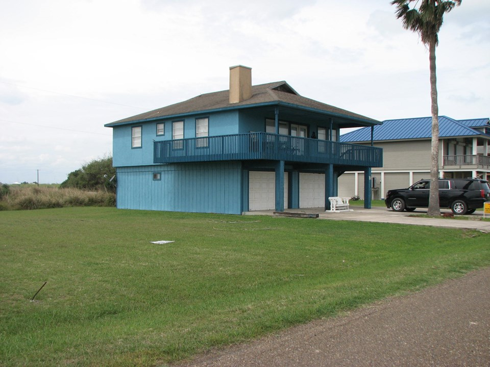 home with 140' feet of frontage on e. maragorda dr there is approximately 1/3 acre of land for this property being sold.