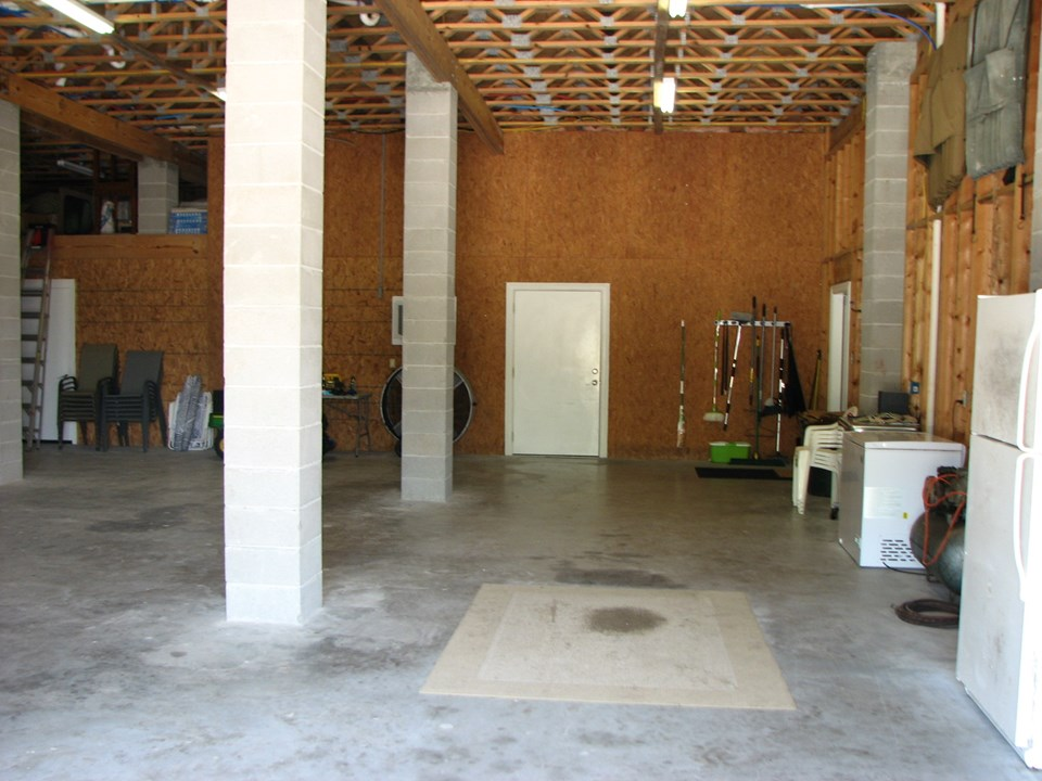 garage interior to the right of the refrigerator on your right (not in the picture) is the freight elevator that leads to the owner's balcony on the second floor.