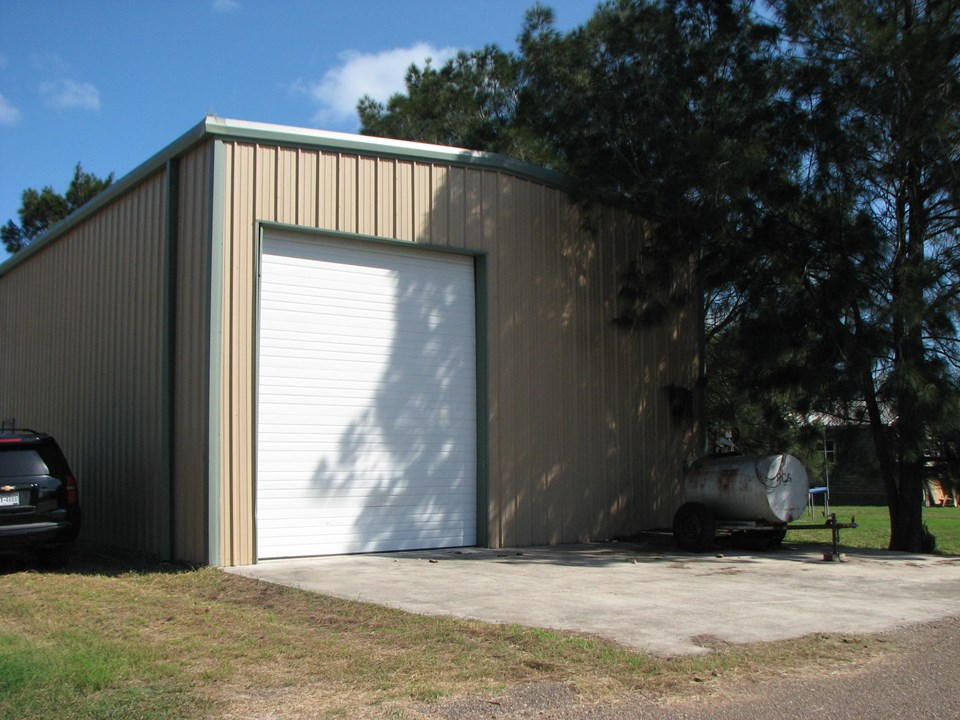 there are two 12'x14' overhead doors, one in the front and one in the back of the building