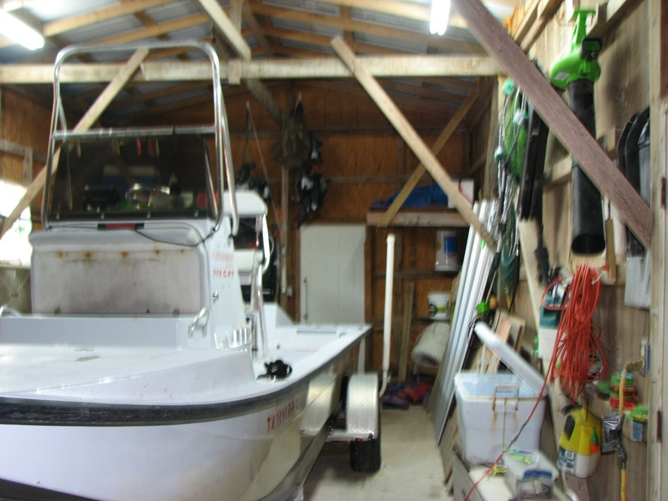 garage/boat barn the door in the background leads to the back yard