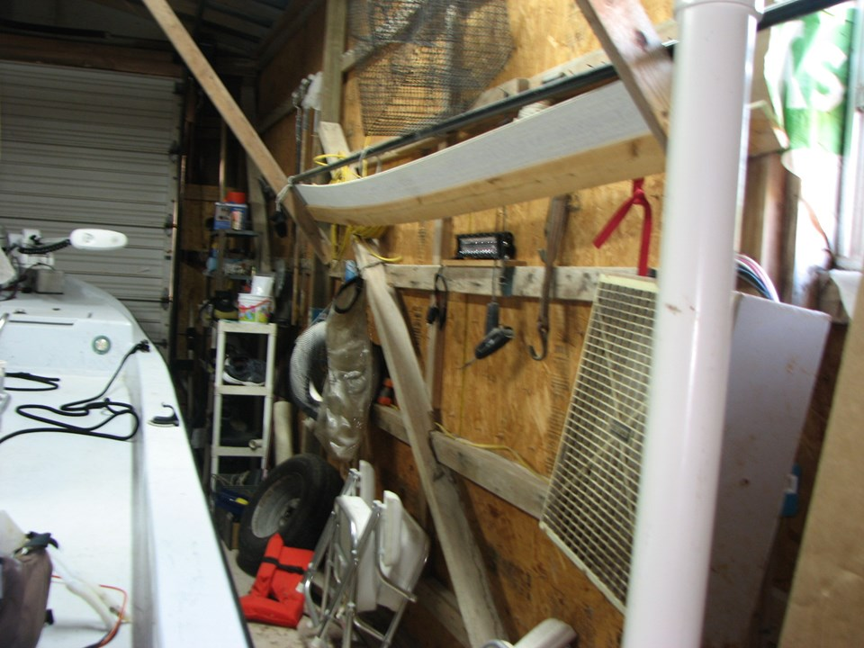 the owner will be removing all equipment, boat, motor, trailer, tools, etc. prior to closing