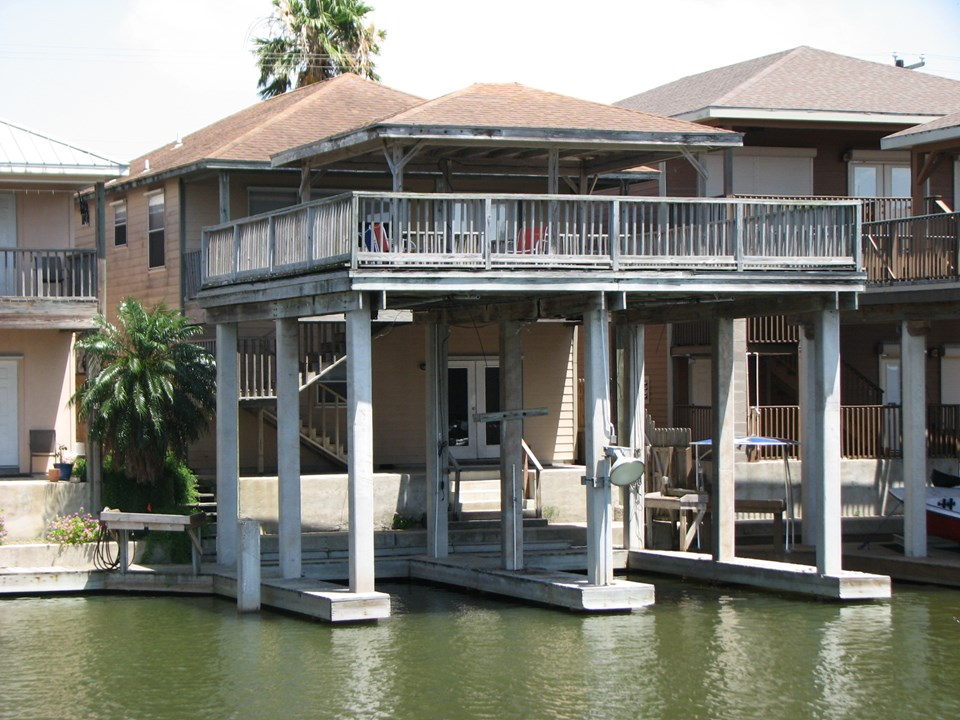 two covered boat slips and a covered deck right outside your front door