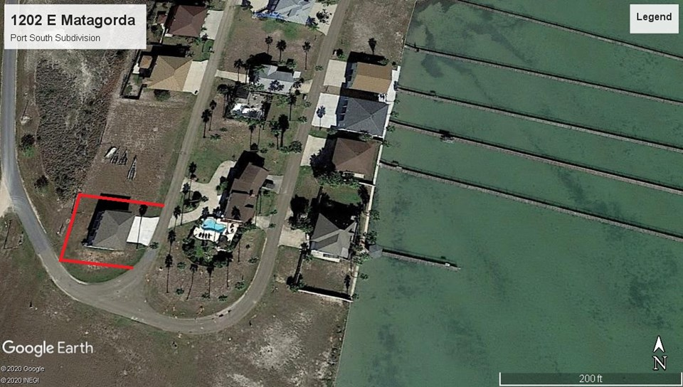 aerial view of home with laguna madre bay view