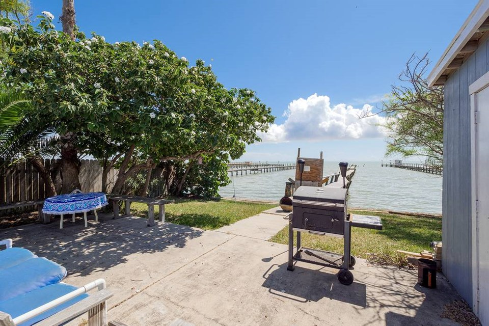 the home faces east, so you can enjoy those spectacular sunrises over the bay! in the evening you can sit out on the waterfront in the shade with that relaxing drink of your choice!.  what a view!