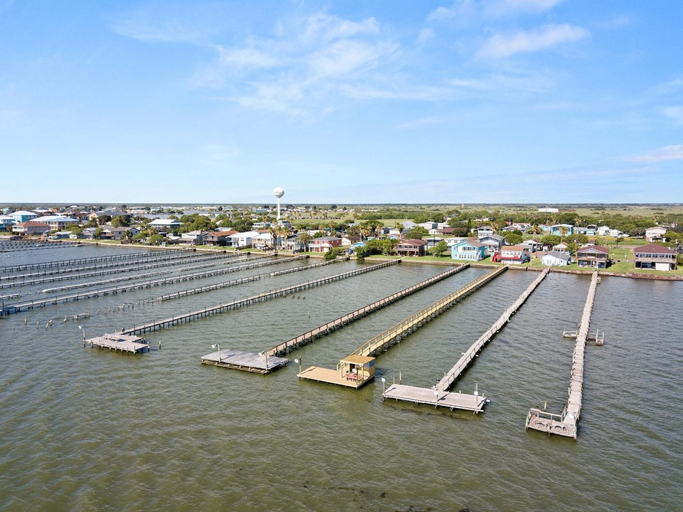 view of the lower laguna madre bay the pier and t-head for this home is the fourth one from your right.  notice how large the t-head is.