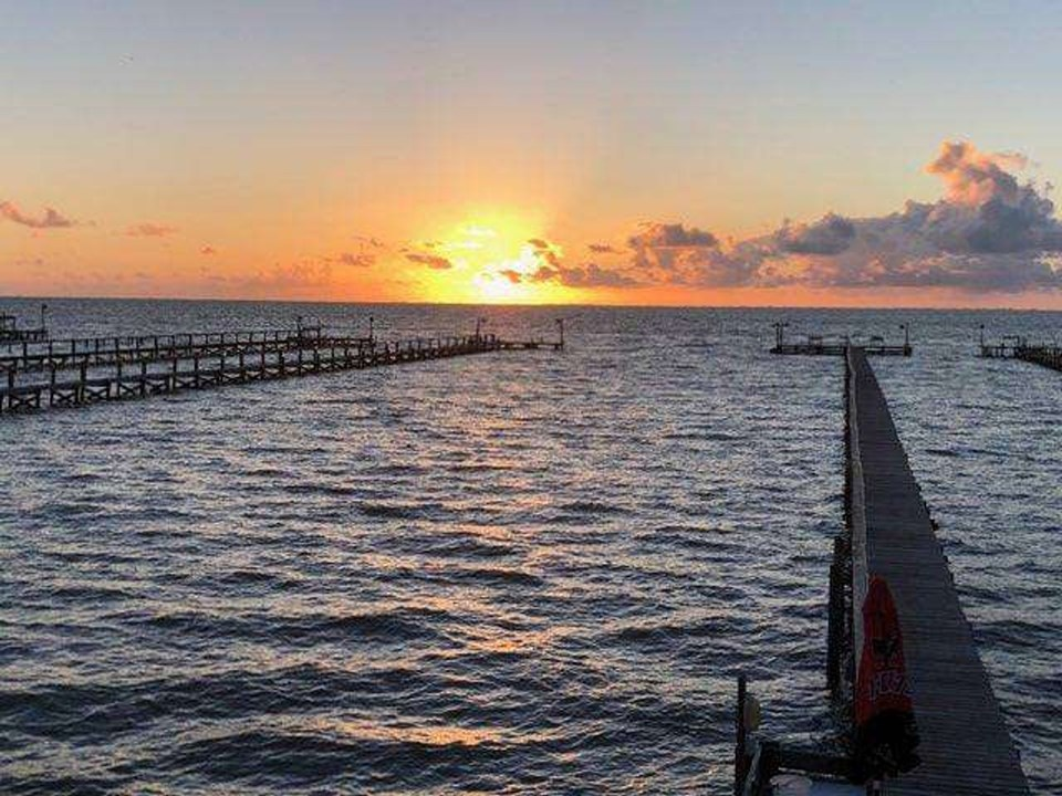 your own private lighted fishing pier and it faces east for those beautiful sunrises! this recently built pier has 316 stainless steel bolts and washers, and has 2x6 walkway with double stringers and deck screws.  the t head has a step-down for easier fishing, and includes a cleaning station with running water.