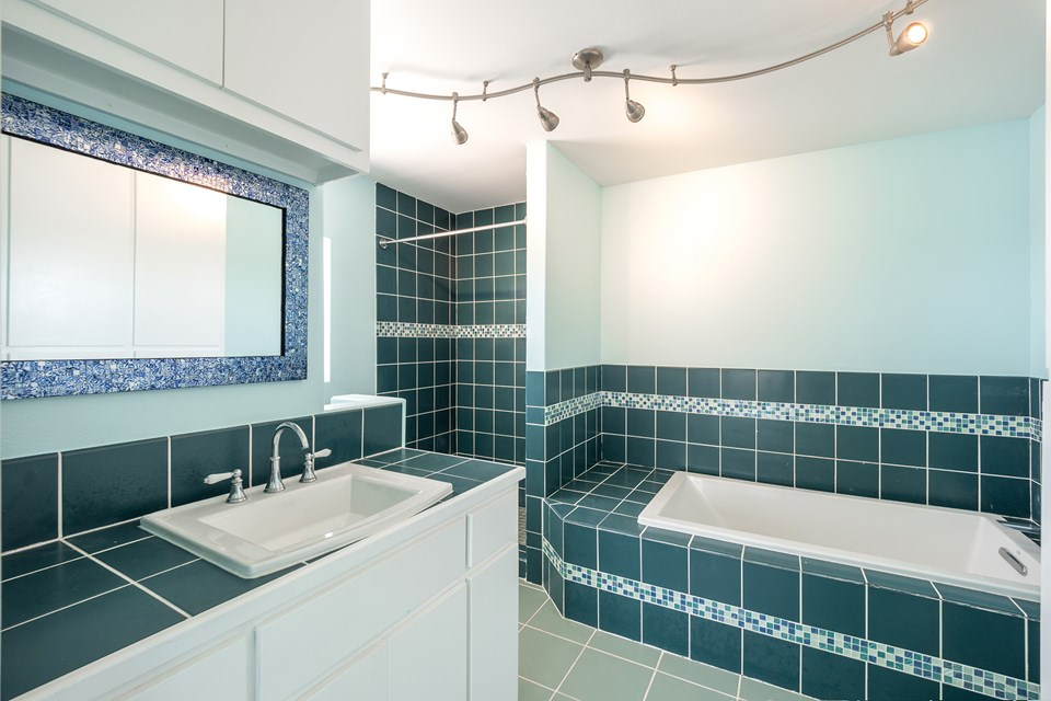 beautiful remodeled full bath with soaking tub and large custom shower