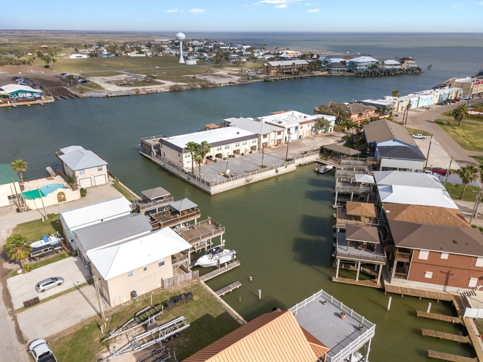 aerial view of neighborhood easy access to the main harbor through the channel on your left.  this home and waterfront is protected from the wind and wave action in the main harbor.